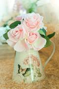 artificial roses bouquet flowers arrange for decoration in home - stock photo