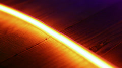 Golden red neon light on wooden background Stock Footage