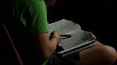 Scanning Bible at church, reading (young youth kid) (devotions) Stock Footage