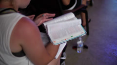 Bible and note taking during a church service sermon Stock Footage