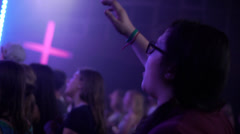 Worship with cross in background, hands raised at church (sing singing praise) Stock Footage