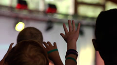 Praise and worship - child kid raising hand arms raised at church Stock Footage