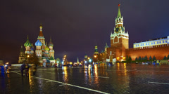 Red Square, Moscow Kremlin and St. Basil Cathedral at rainy night, time-lapse. - stock footage
