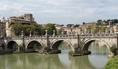 tiber river and saint angel bridge seen from castel san angelo - stock photo