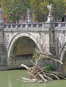 tiber river and saint angel bridge - stock photo