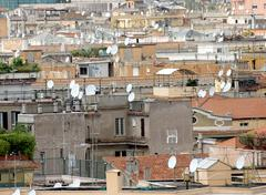 Roofs of the metropolis with lots of antennas and antenna for reception signa Stock Photos