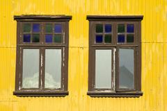 Yellow building and windows - stock photo