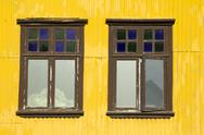 Stock Photo of Yellow building and windows
