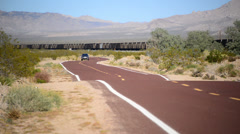 Desert Road with Freight Train in the distance Mojave Preserve Stock Footage