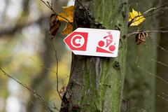 trail direction cyclist sign. - stock photo