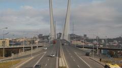 Metropolis. In big city heavy traffic. Bridge of the Golden Horn,Vladivostok Stock Footage