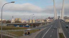 Metropolis. In big city heavy traffic. Bridge of the Golden Horn, Vladivostok Stock Footage