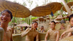 People at mud bathing spa Stock Footage