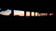 Time Lapse Dolly of Abandon Bus in the Desert at Sunset Stock Footage