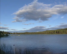 Lule river near Jokkmokk flowing in Swedish pine forest landscape + pan Stock Footage