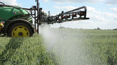 Tractor spray chemicals for crop plant protection from weed pest Stock Footage