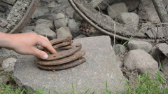 Stack of retro horse shoes on stone and hand take off them Stock Footage