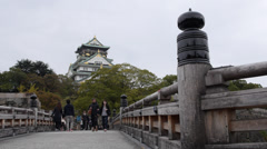 Main Tower of Osaka Castle in Japan with Tourists on Bridge Stock Footage