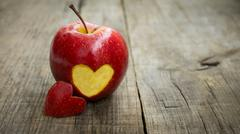 apple with engraved heart - stock photo