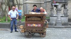 Barrel organ entertains the crowd in Bruges, Belgium. Stock Footage