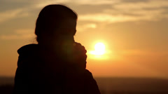 Girl silhouette at dawn (close-up) Stock Footage