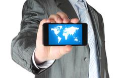 Man holds smart phone with map . Stock Photos