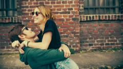 Young couple fooling arround and having fun Stock Footage