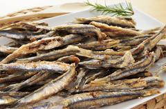 spanish boquerones fritos, battered and fried anchovies typical in spain - stock photo
