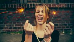 Teenage hipster girl having fun with sparkles Stock Footage
