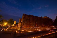 makha bucha candle lit. - stock photo