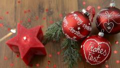 Christmas candle in star shape is lit with a match. - stock footage