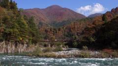 Sho River and Bridge in Shirakawago Stock Footage