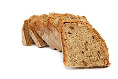 Sliced slices rye bread isolated on white background. Stock Photos
