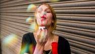 Young hipster girl having fun blowing bubbles Stock Footage
