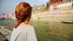 Caucasian tourist girl, indian boat, varanasi ganges river, india - stock footage