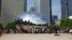 Cloud Gate sculpture in Millenium park on May 18, 2013 in Chicago - stock footage