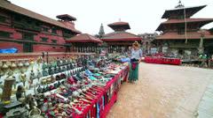 Female tourist choosing souvenir Stock Footage