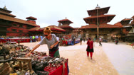 Stock Video Footage of Female tourist choosing souvenir