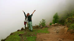 Tourist couple posing on top of himalayas mountain Stock Footage