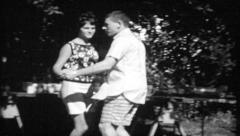 Stock Video Footage of 618 - couple dance at neighborhood barbecue - vintage film home movie