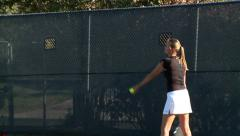 Tennis game - girl serving tennis ball in slow motion Stock Footage