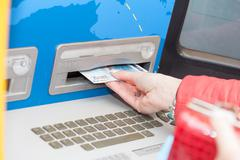 Woman taking banknotes from a bank atm Stock Photos
