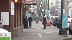 Homeless troubled youth talking to police downtown - stock footage