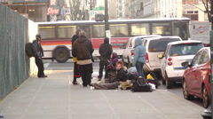 Homeless people loitering on streets downtown (youth men people woman) Stock Footage