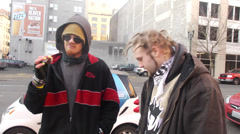 Homeless street youth / thugs smoking and talking Stock Footage