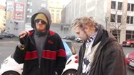 Stock Video Footage of Homeless street youth / thugs smoking and talking