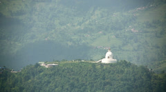 Buddhist stupa with Annapurna in background Stock Footage