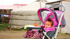 Mongolian Baby at Suburbs Stock Footage
