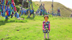 Mongolian girl posing in front of shaman Adak Stock Footage