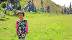 Mongolian girl posing in front of shaman Adak Stock Footage